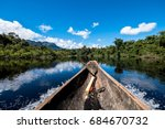 sailing down river amidst the... | Shutterstock . vector #684670732