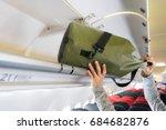 passenger woman putting luggage ... | Shutterstock . vector #684682876