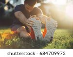 young man runner stretching... | Shutterstock . vector #684709972