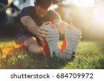 young man runner stretching... | Shutterstock . vector #684709972