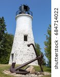 Small photo of PRESQUE ISLE, MI, JULY 3, 2013: The Old Presque Isle Lighthouse, built in 1840 and in service until 1870, is said to be haunted by ghosts, who scream and activate the permanently disabled light.