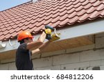 worker installs the gutter...   Shutterstock . vector #684812206
