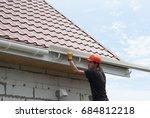 worker installs the gutter...   Shutterstock . vector #684812218
