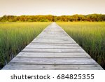 long wooden walkway with... | Shutterstock . vector #684825355