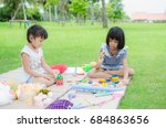 child happy play toy in park | Shutterstock . vector #684863656