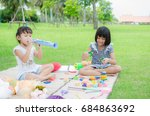 child happy play toy in park | Shutterstock . vector #684863692