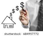 businessman hand drawing a...   Shutterstock . vector #684957772