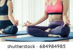 women doing yoga lotus pose ...   Shutterstock . vector #684984985