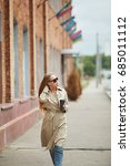 stylish girl in a beige coat in ... | Shutterstock . vector #685011112