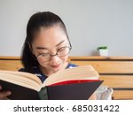 asian woman is reading book on... | Shutterstock . vector #685031422