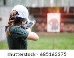 woman in practice shooting gun...   Shutterstock . vector #685162375