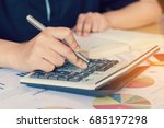 woman hand using calculator and ... | Shutterstock . vector #685197298
