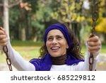 happy mature woman on swing... | Shutterstock . vector #685229812