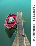 red boat moored to wooden pier | Shutterstock . vector #685236952