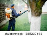 pesticides spraying. farmer... | Shutterstock . vector #685237696
