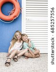 brother and sister cuddling on... | Shutterstock . vector #685257556