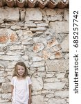 pretty girl in front of a stone ... | Shutterstock . vector #685257742