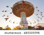 A Pink Carousel Ride Spins Fas...