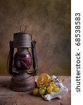Still life with lantern and grapes with lemon - stock photo
