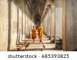 Small photo of Two neophytes walking in an Angkor Wat, Siem Reap, Cambodia.