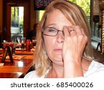 Small photo of Slightly sozzled model at the bar adjusting her glasses
