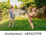 two girls splashing each other... | Shutterstock . vector #685423798