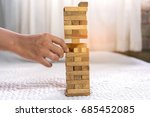 man pulling out wood block on... | Shutterstock . vector #685452085