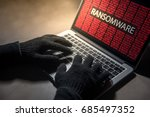 male hacker hand hacking into... | Shutterstock . vector #685497352