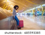 woman waiting her flight using... | Shutterstock . vector #685593385