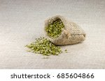 Small photo of Broken Mung Lentils (Moong Dal) spilled out from jute sack