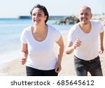 joyful mature couple in white t ... | Shutterstock . vector #685645612