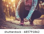 woman runner tying shoelaces on ... | Shutterstock . vector #685791862