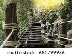 Wooden Stairs Among Green Tree...
