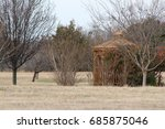 Gazebo And Trees In A Field