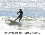 surfers enjoying good waves at... | Shutterstock . vector #685976542