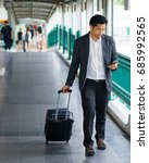 business traveler pulling... | Shutterstock . vector #685992565