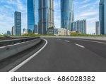 empty asphalt road front of... | Shutterstock . vector #686028382