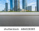empty asphalt road front of... | Shutterstock . vector #686028385