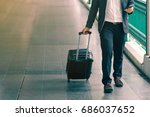 business traveler pulling... | Shutterstock . vector #686037652