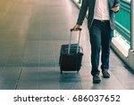 business traveler pulling... | Shutterstock . vector #686037652