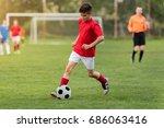 kids soccer football   young... | Shutterstock . vector #686063416