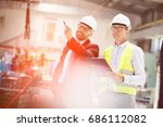 mid adult male supervisors... | Shutterstock . vector #686112082