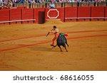 "SEVILLE - APRIL 30:  A bull chases Bullfighter David Fandila ""El Fandi"" as he fights for a sold out crowd at the Plaza de Toros de Sevilla April 30, 2009 in Seville, Spain. - stock photo"