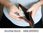 Small photo of Women use money from wallets. Pay the dollar pay.
