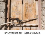 An Old Faded Wooden Door With...