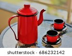 The Red Teapot And Metal Cups...