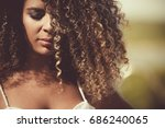 pretty black woman with curly... | Shutterstock . vector #686240065