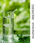 cool fresh water with ice and... | Shutterstock . vector #686240302