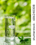 cool fresh water with ice and... | Shutterstock . vector #686240308