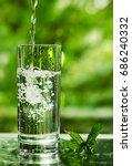 cool fresh water with ice and... | Shutterstock . vector #686240332